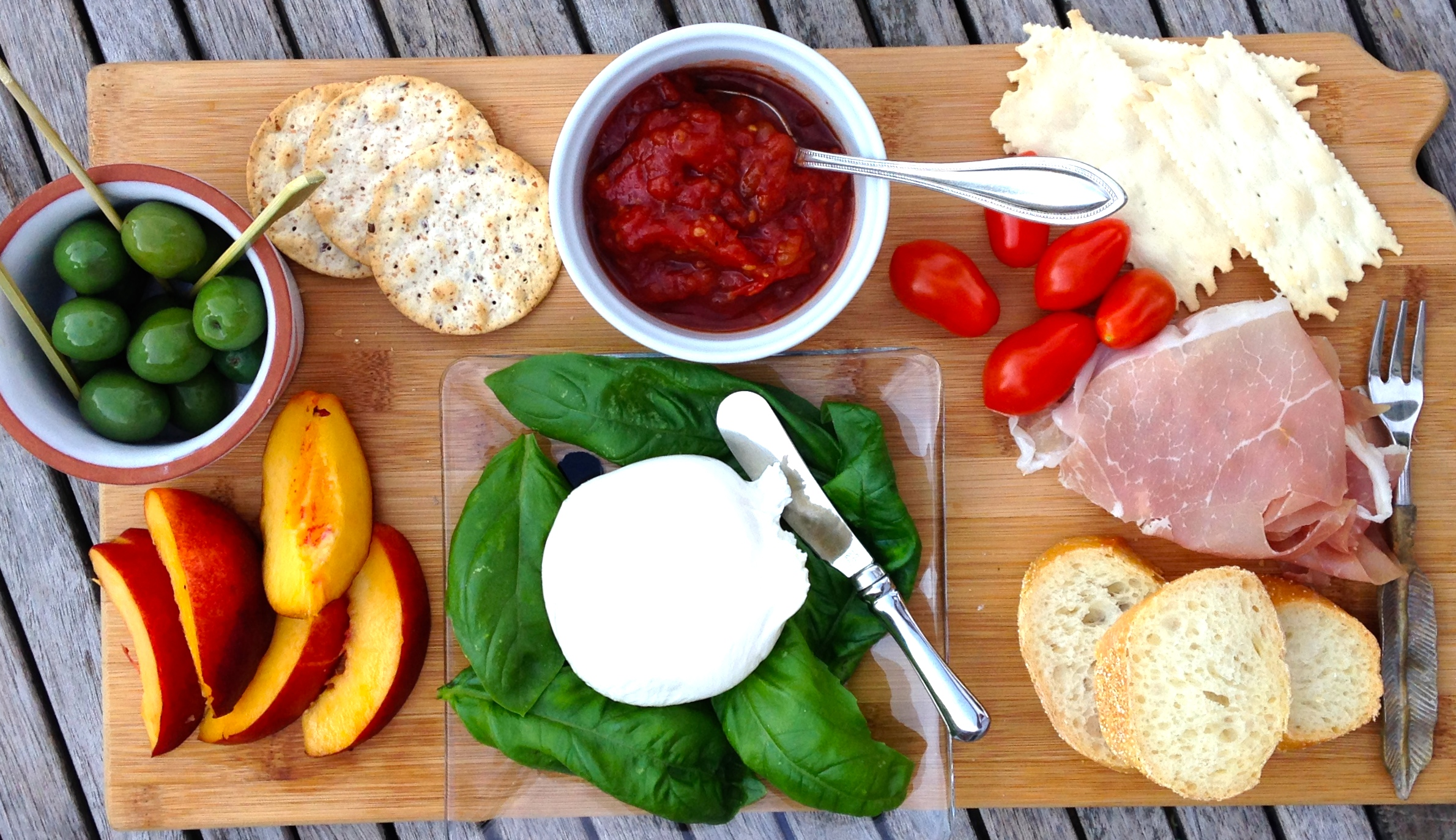 life on the deck is delicious with fruit and cheese board