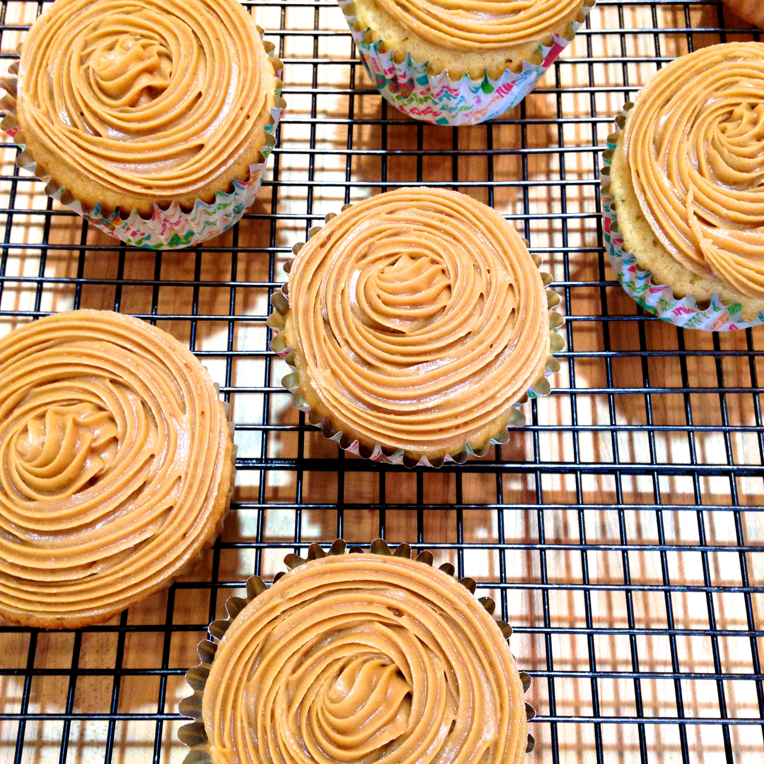 frosted cupcakes on cooling rack