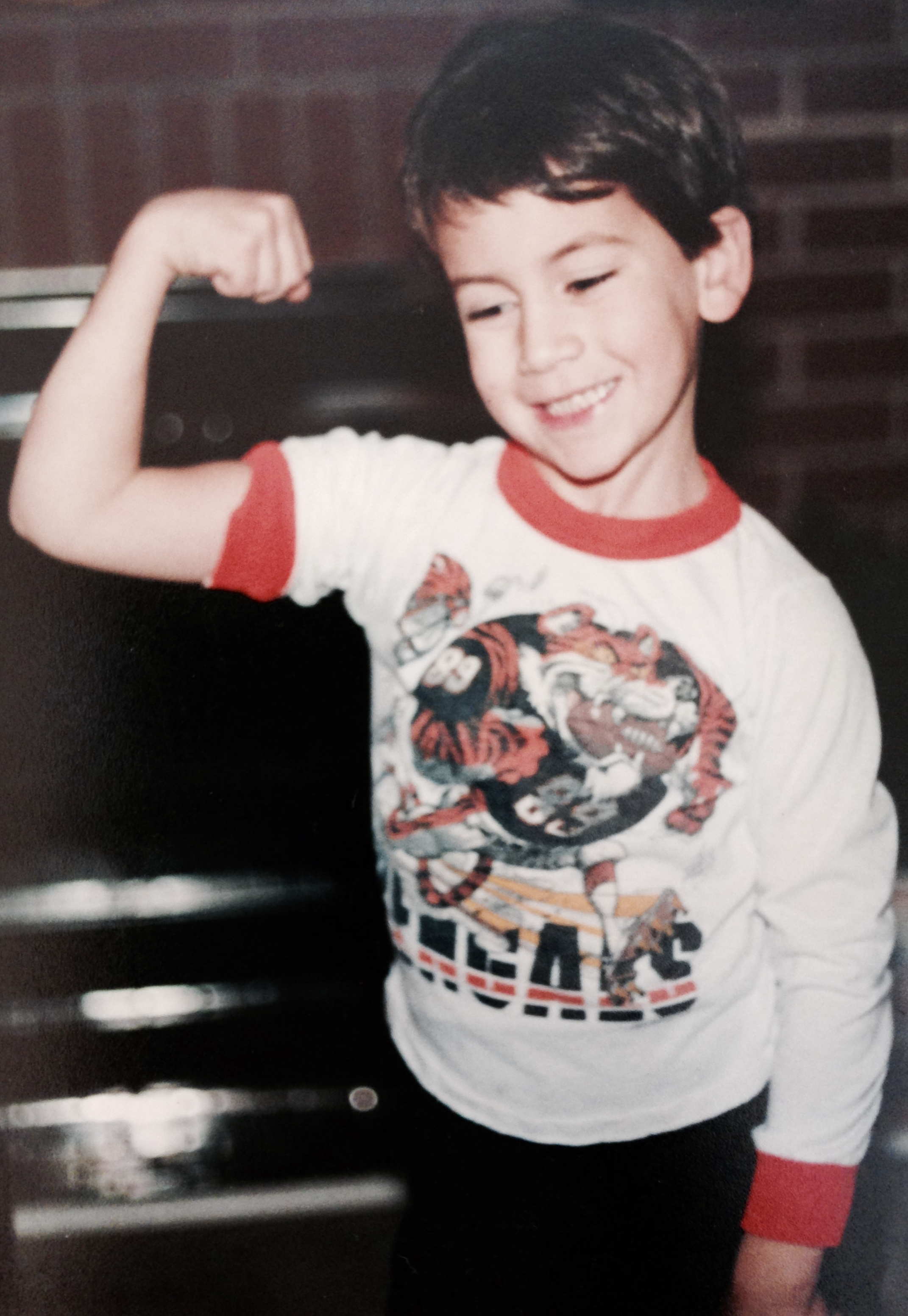 be strong son flexing his muscles