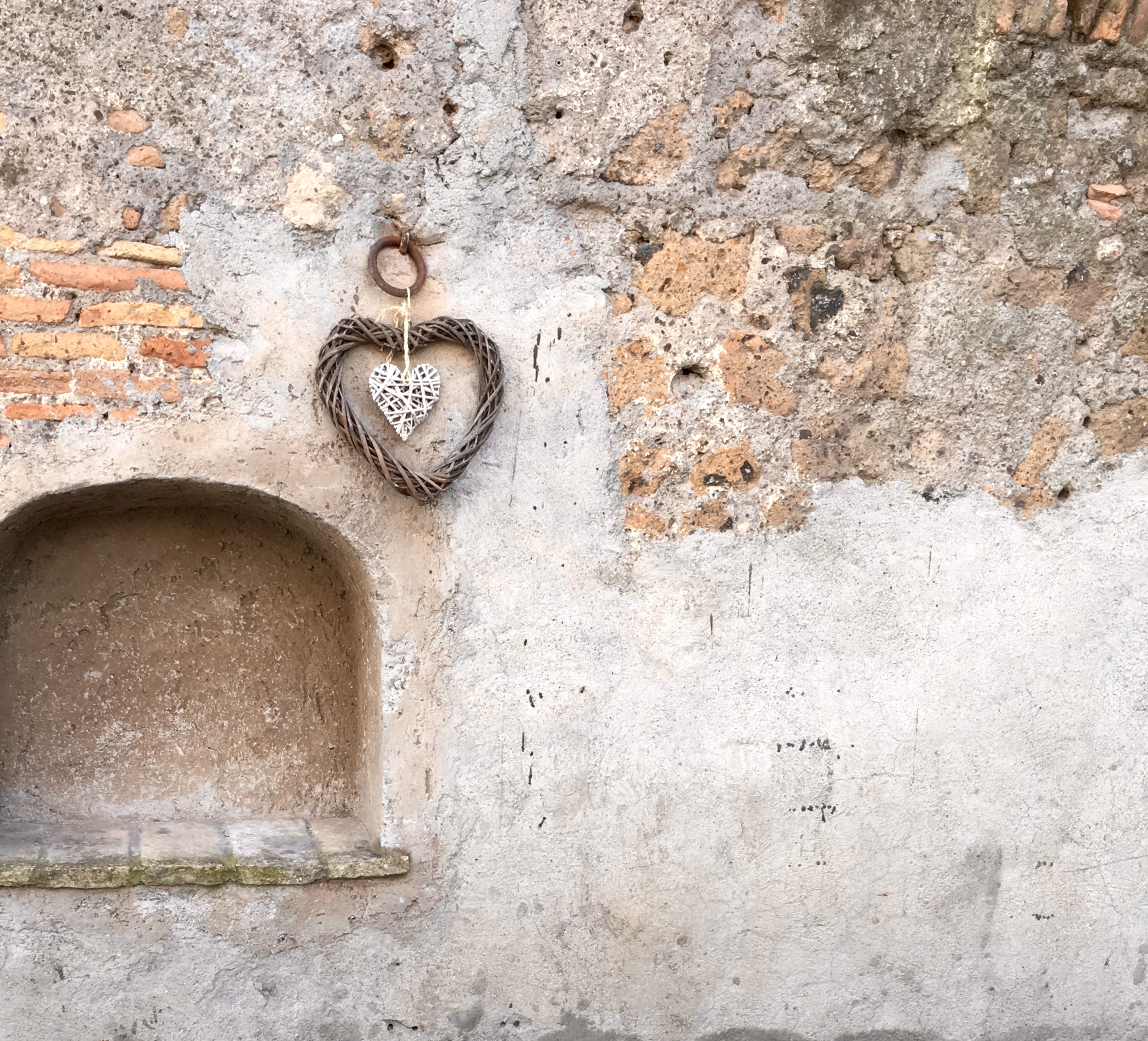 heart decorations on an old Italian building