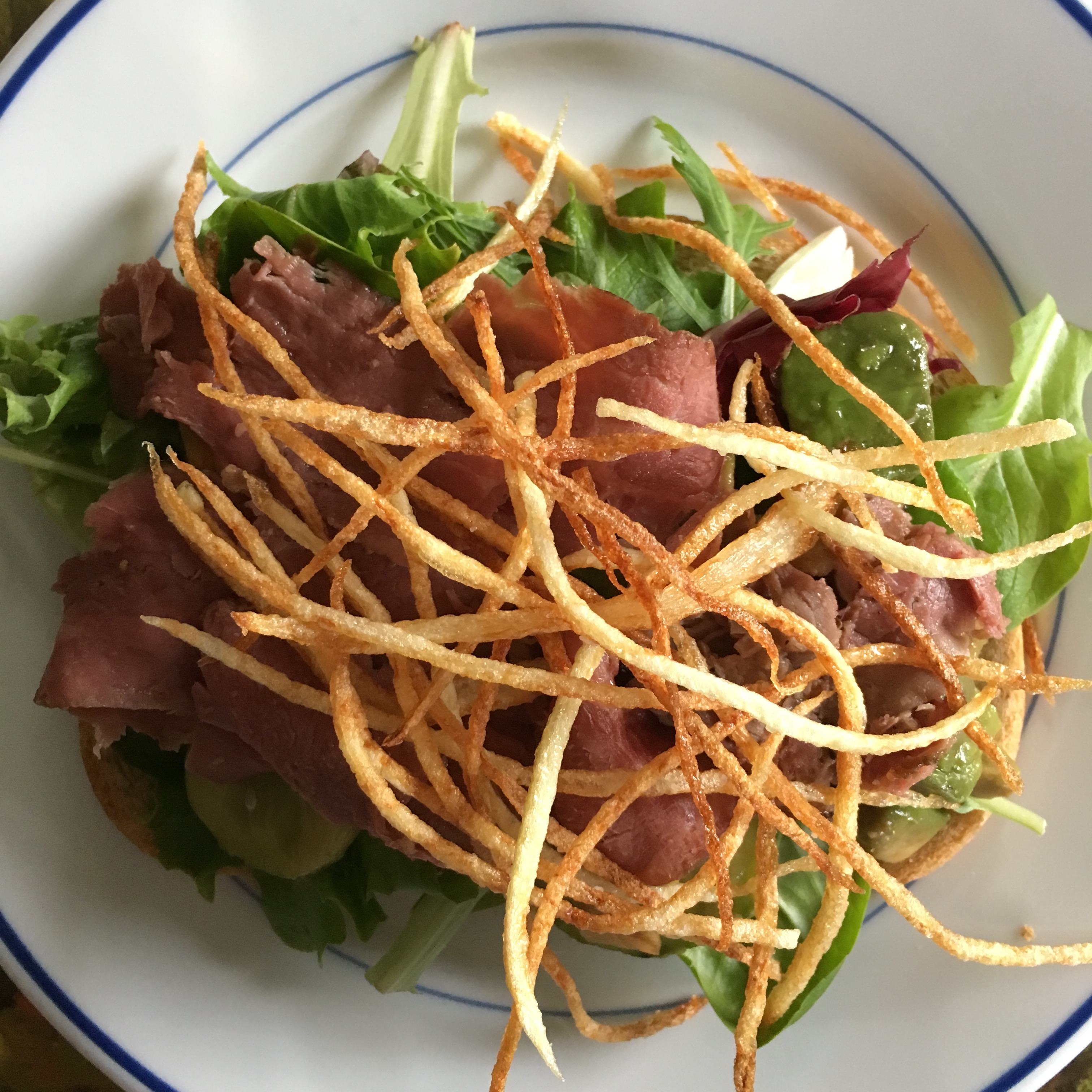 shoestring fried potatoes on sandwich