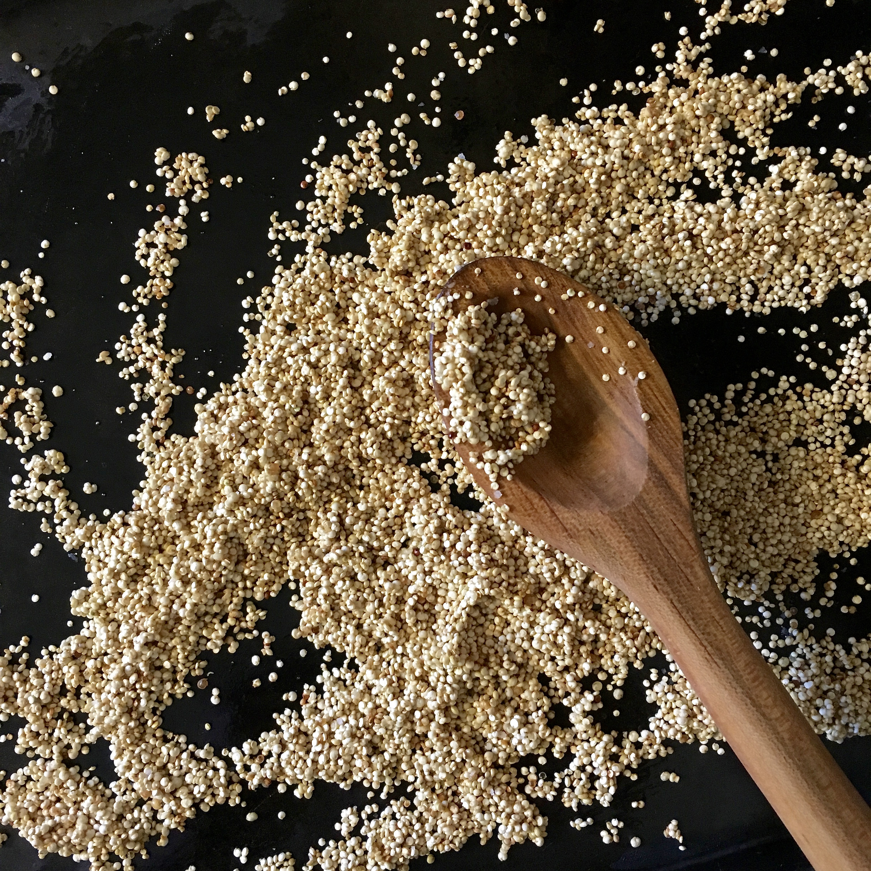 quinoa with wooden spoon