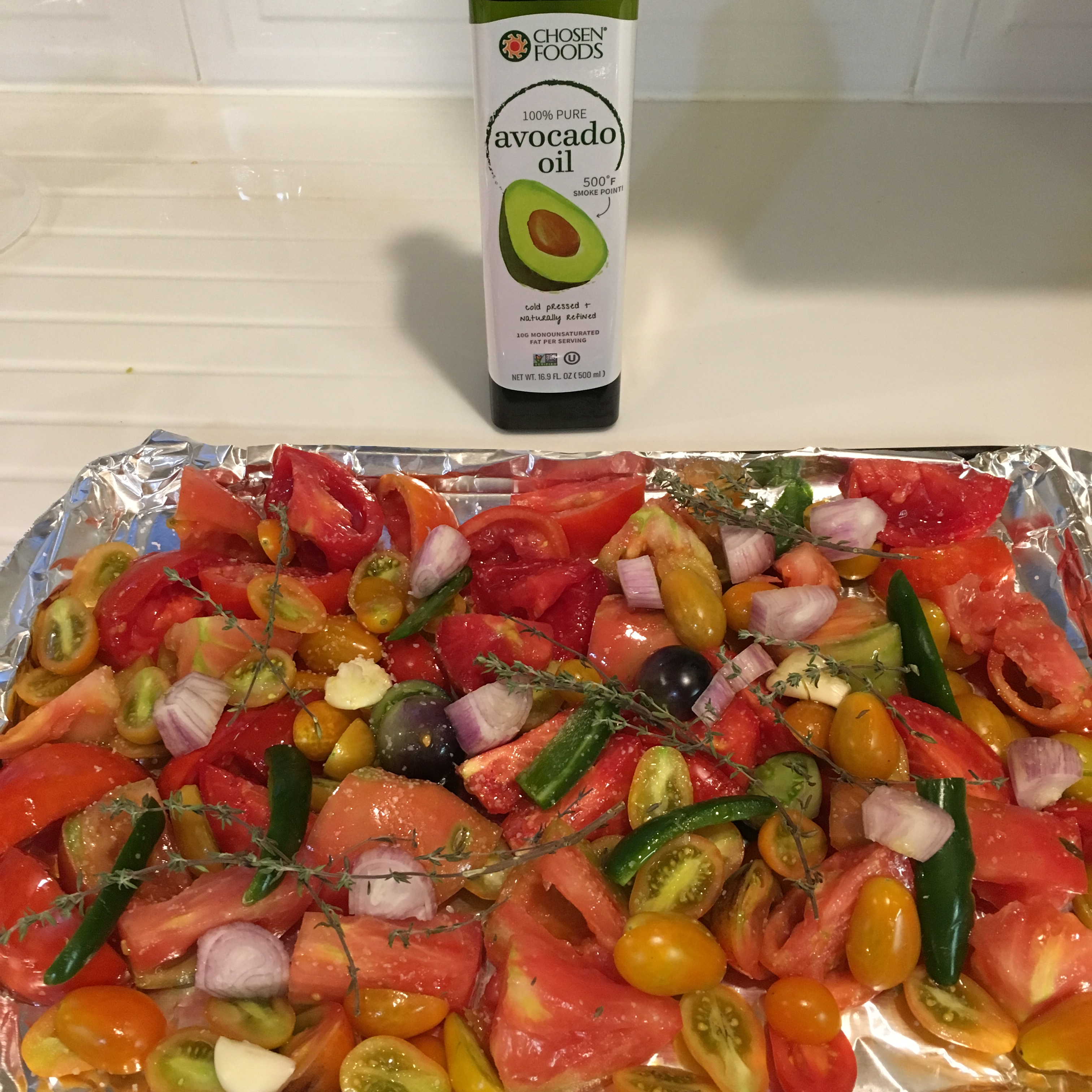 roasted vegetables and avocado oil bottle