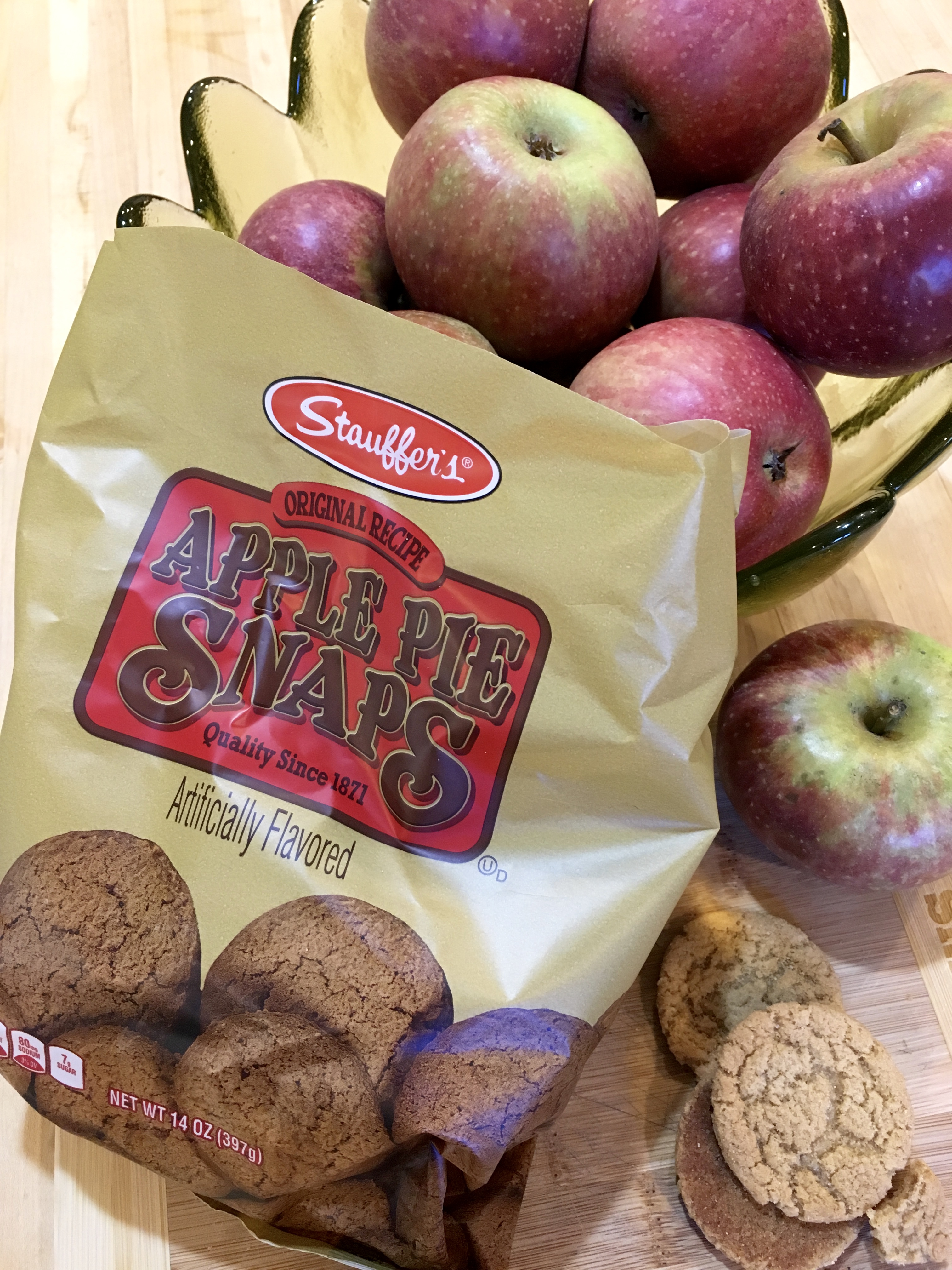 package of apple pie snap cookies and an apple