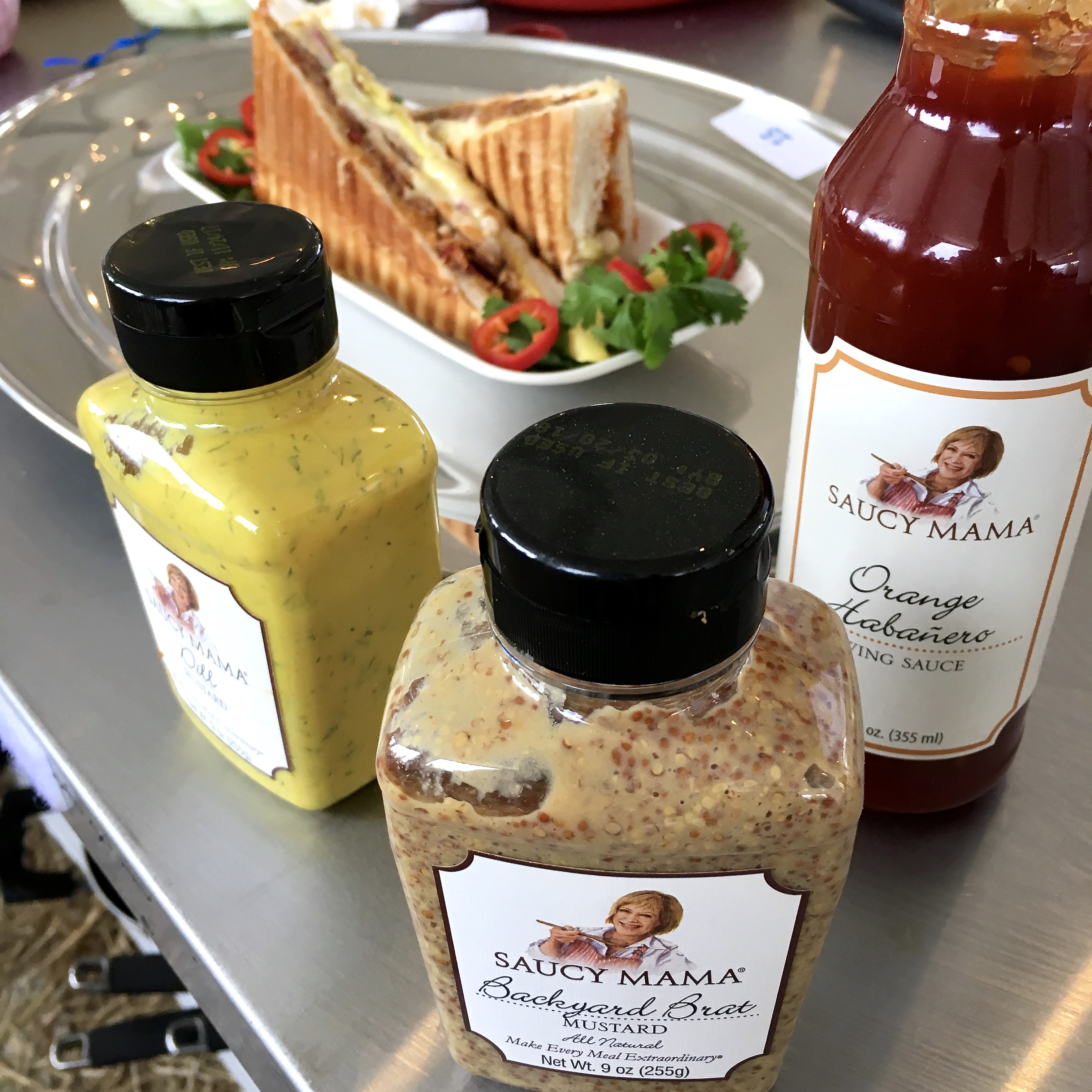 Saucy Mama products and cuban sandwich