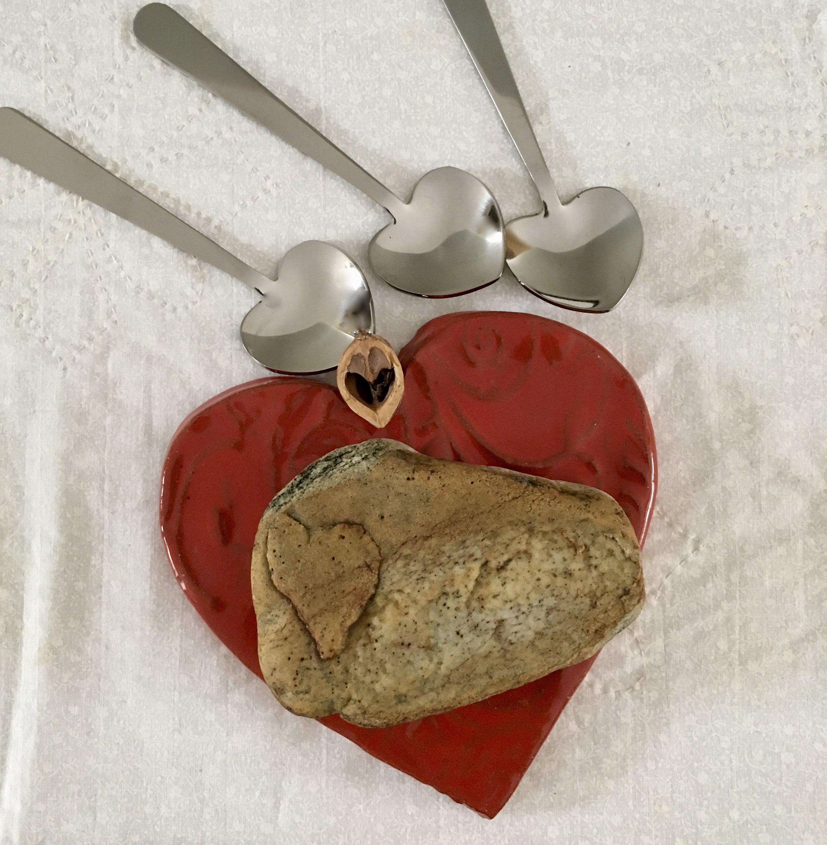 heart shaped stones, spoons and nuts