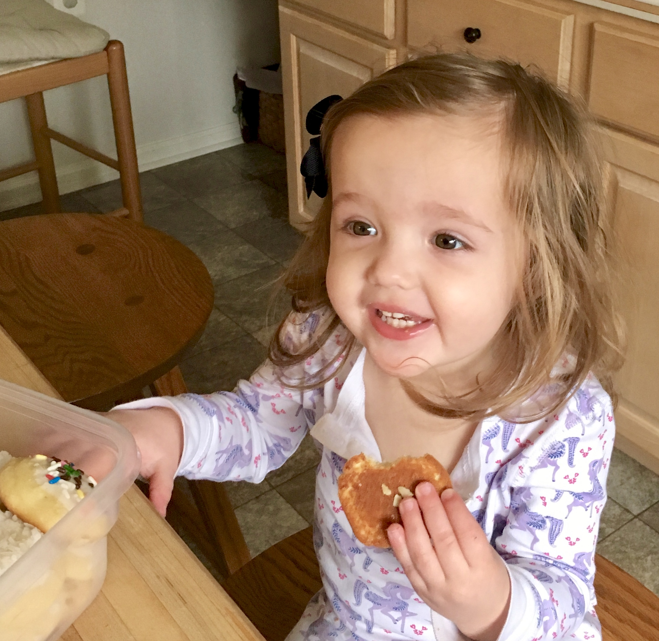 grand daughter eating a cookie