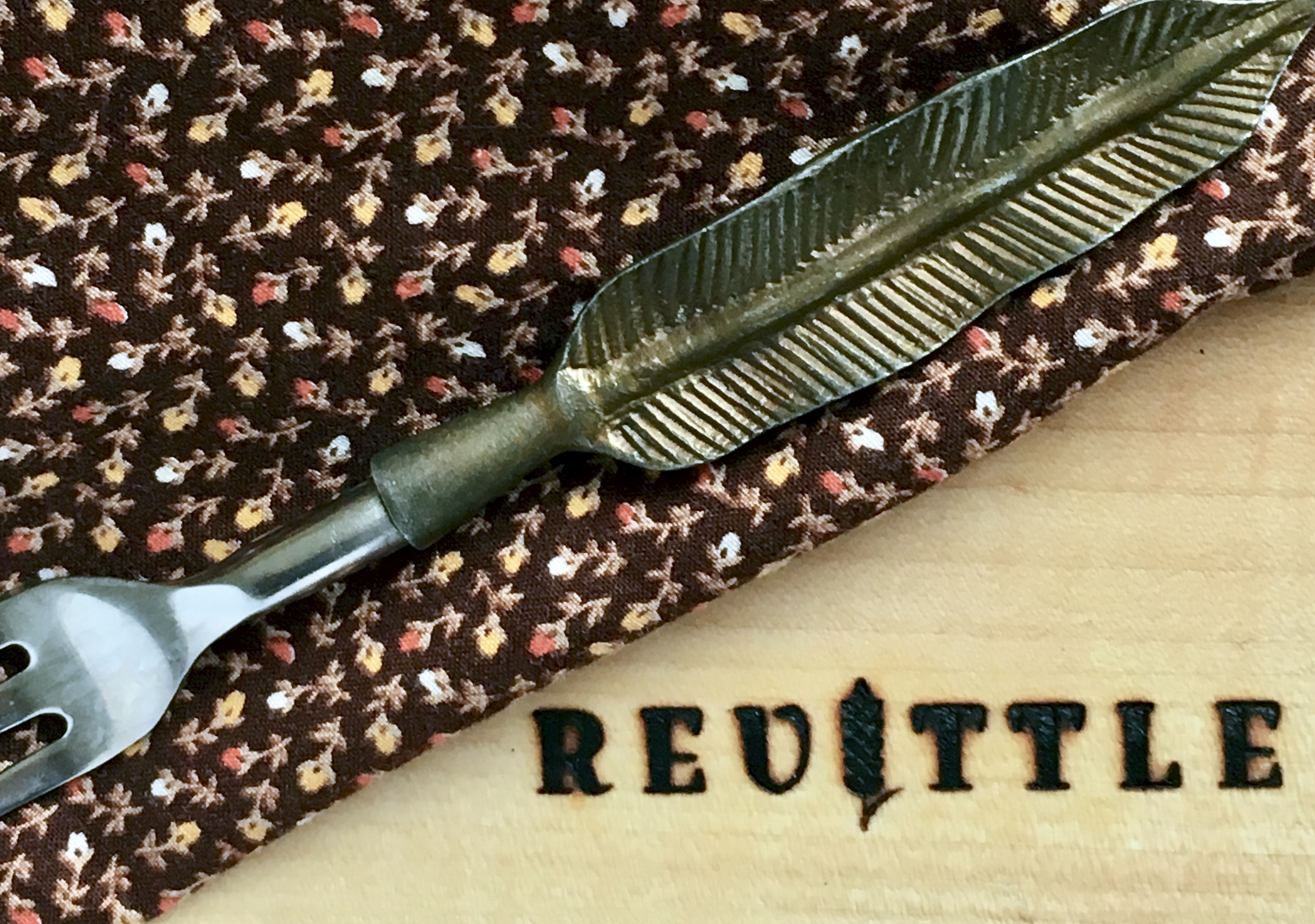 revittle cutting board with napkin and fork