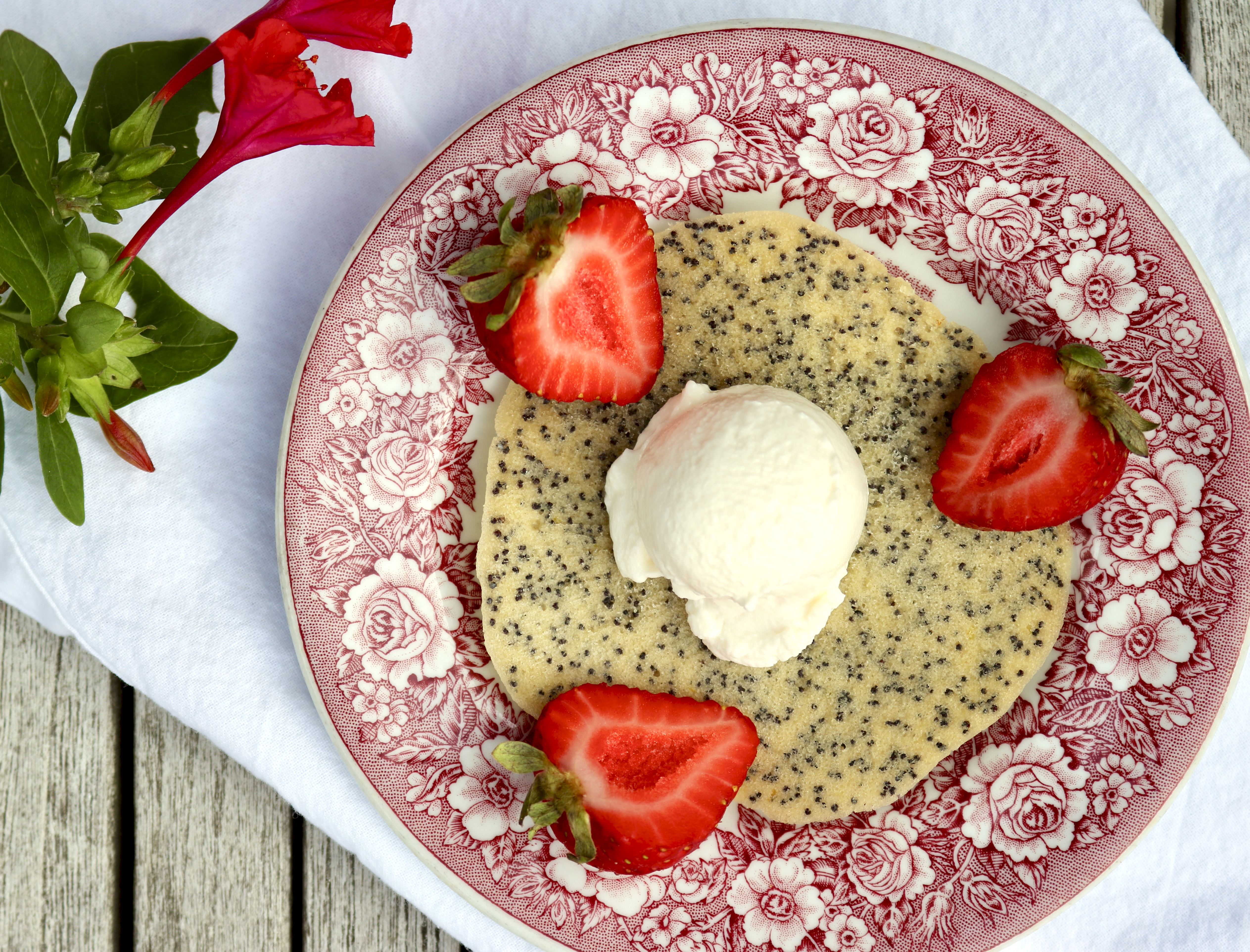 cookie topped with ice cream and strawberries