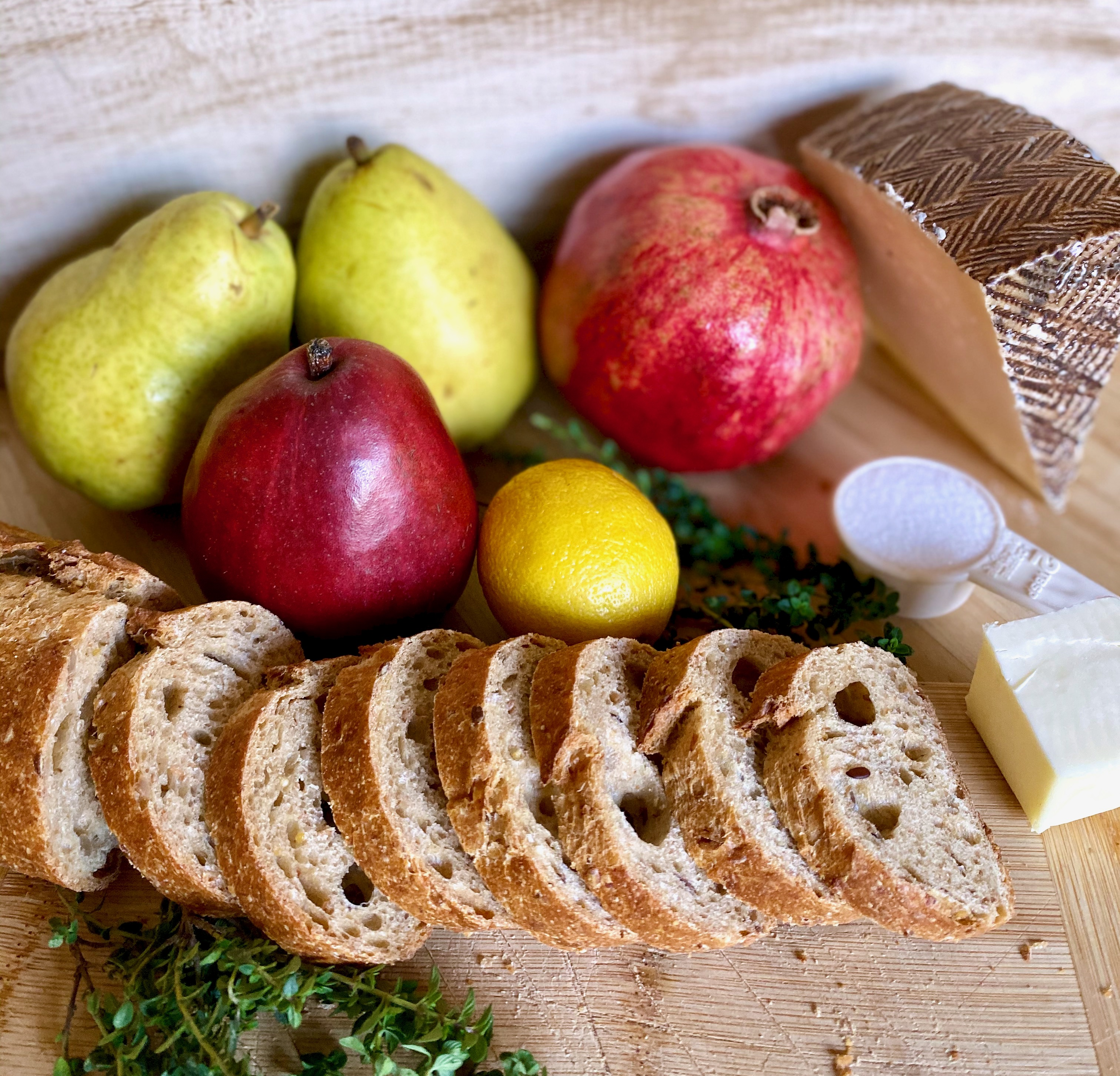 recipe ingredients: pears, bread, cheese, pomegranate, thyme, sugar, lemon