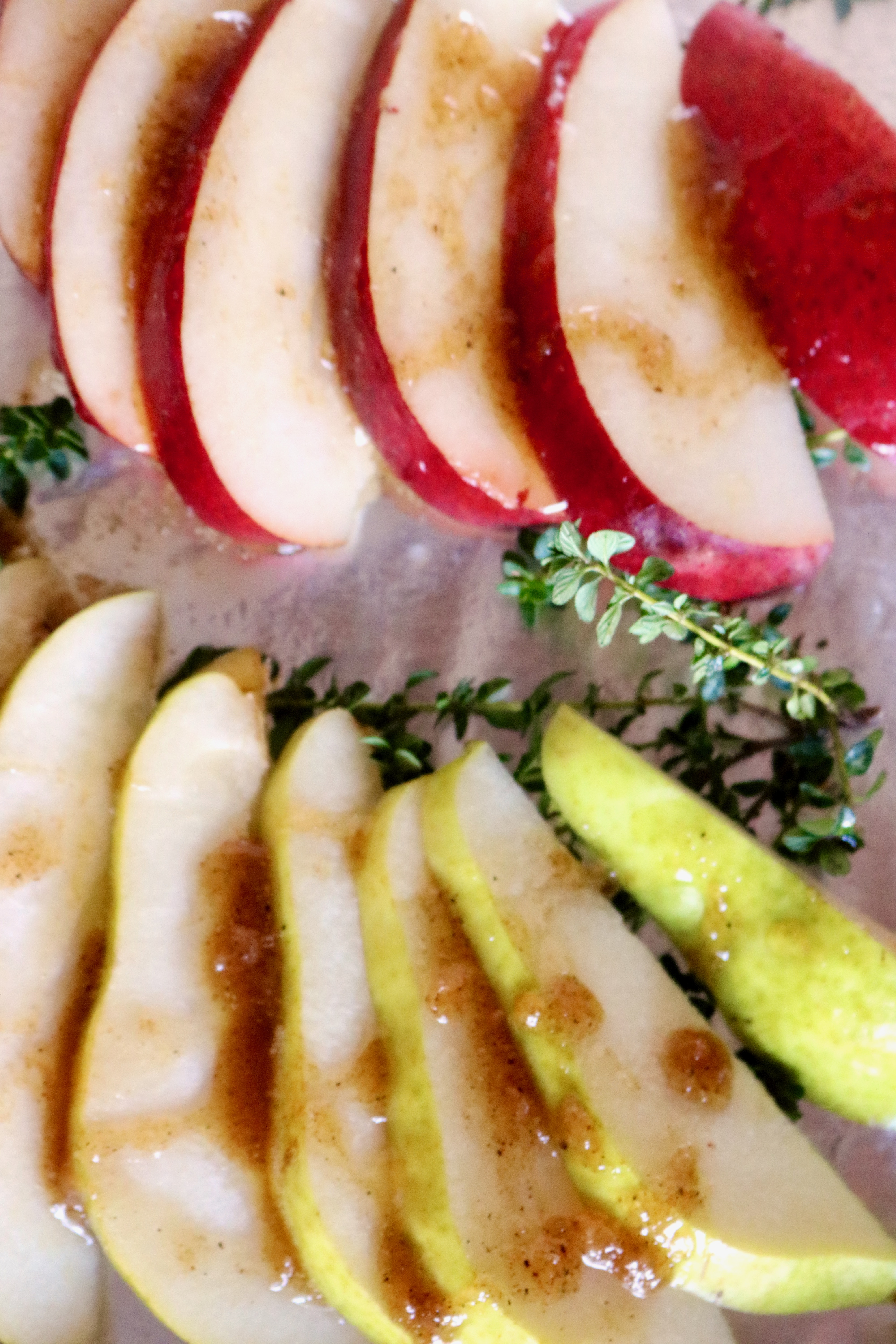 sliced pears with dressing and herbs