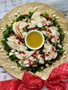 pear salad on gold platter with red bow
