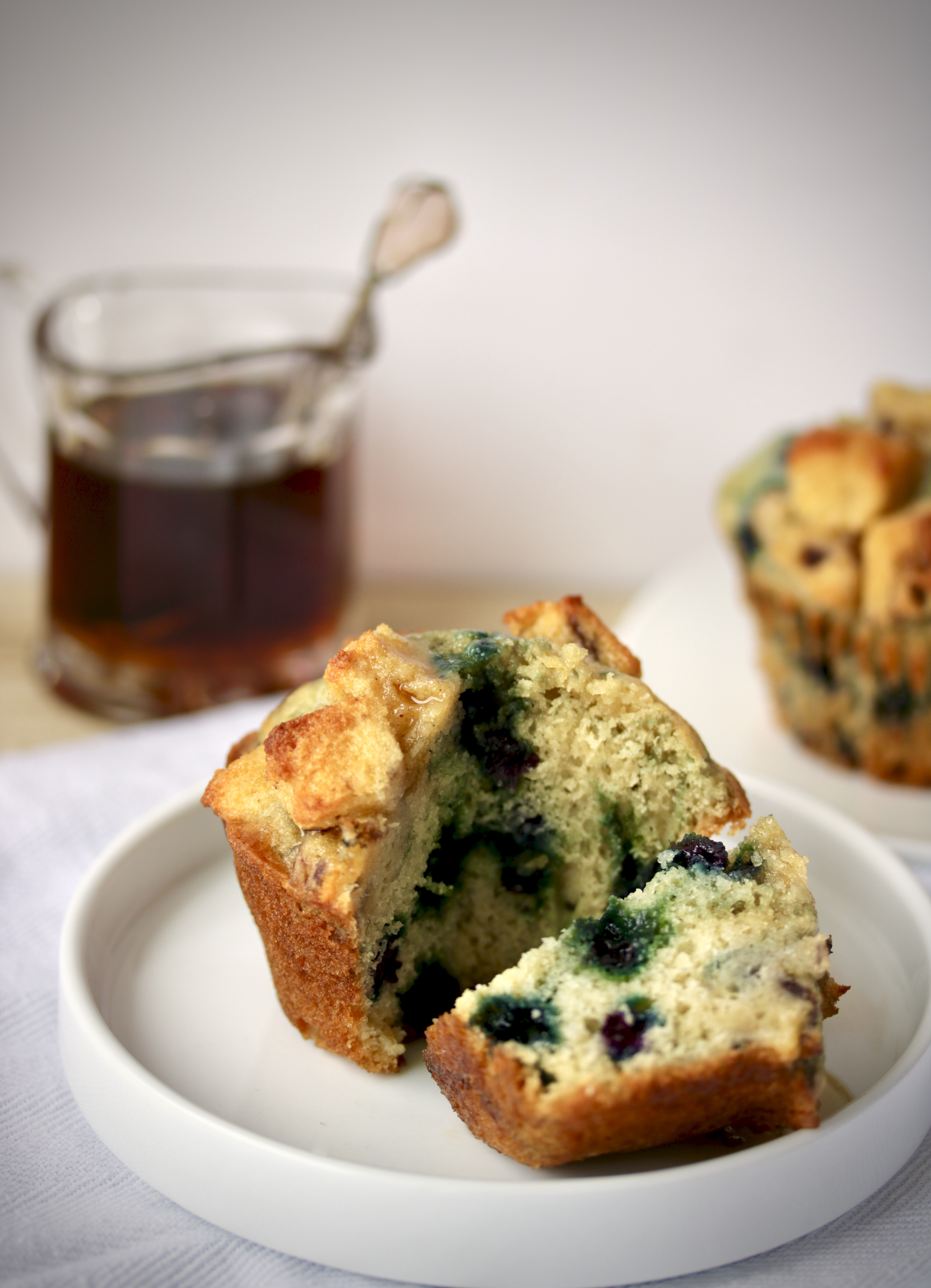 cut muffin with maple syrup