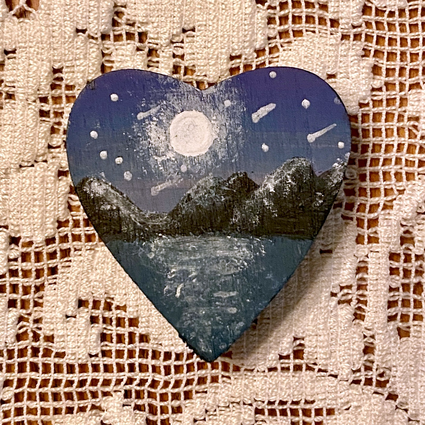 blue painted heart on doily