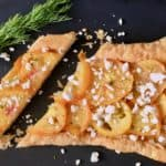 sliced yellow tomato tart with feta and dill