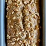 loaf of banana bread topped with nuts
