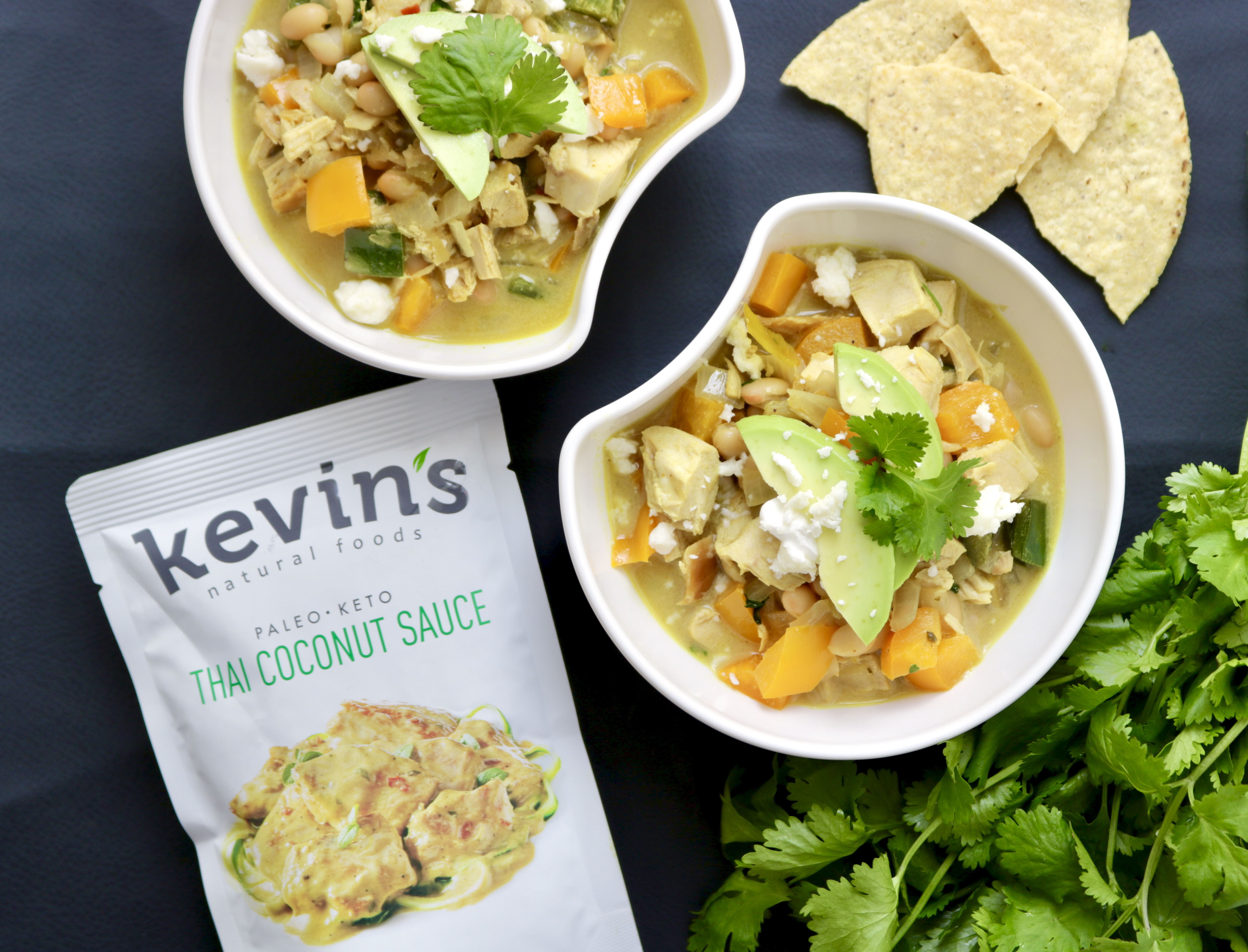 product package with bowls of chili, chips, cilantro