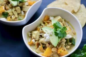 bowl of Thai chicken chili topped with avocado and tortillas