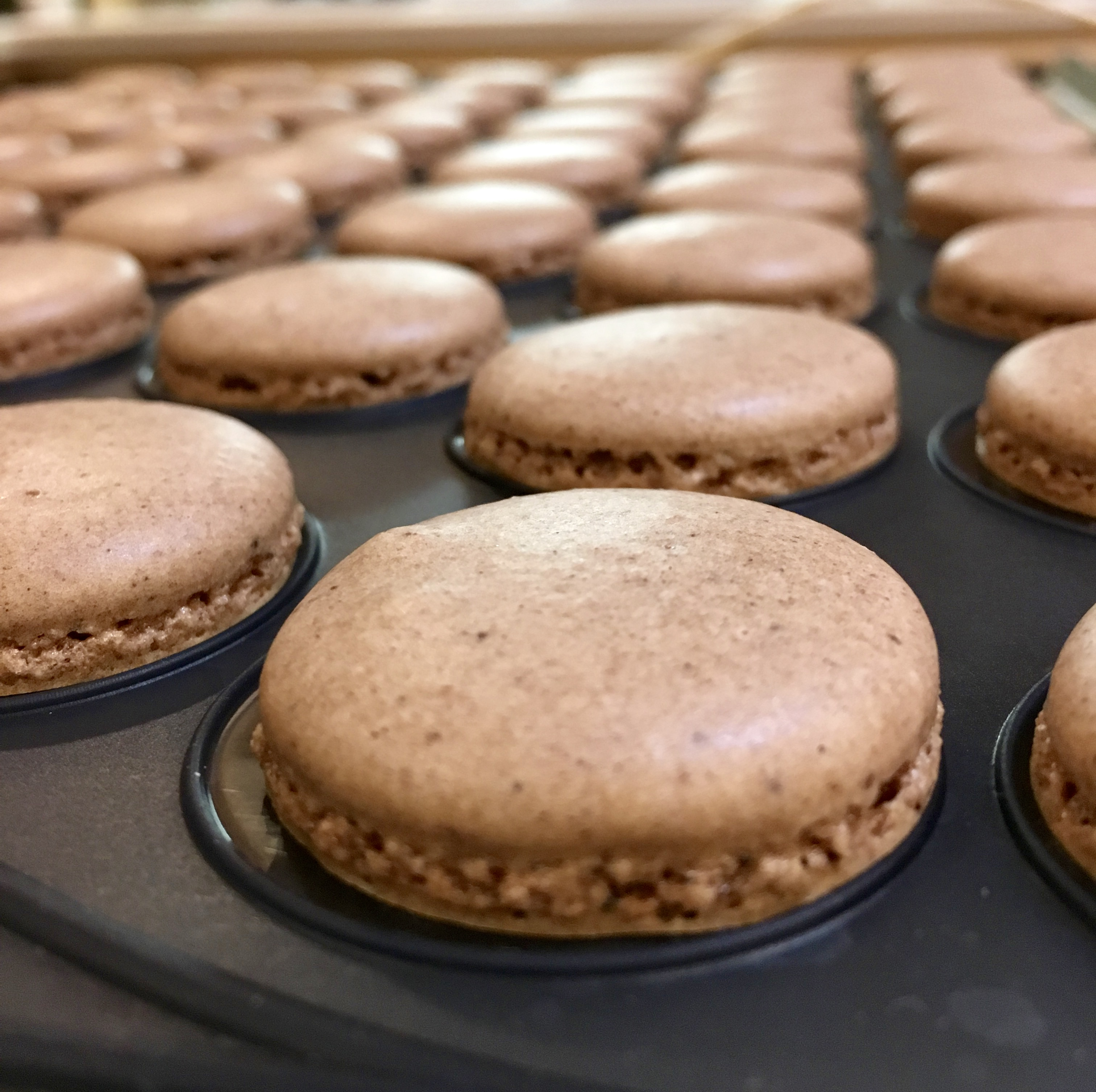 baked chocolate macaron showing foot