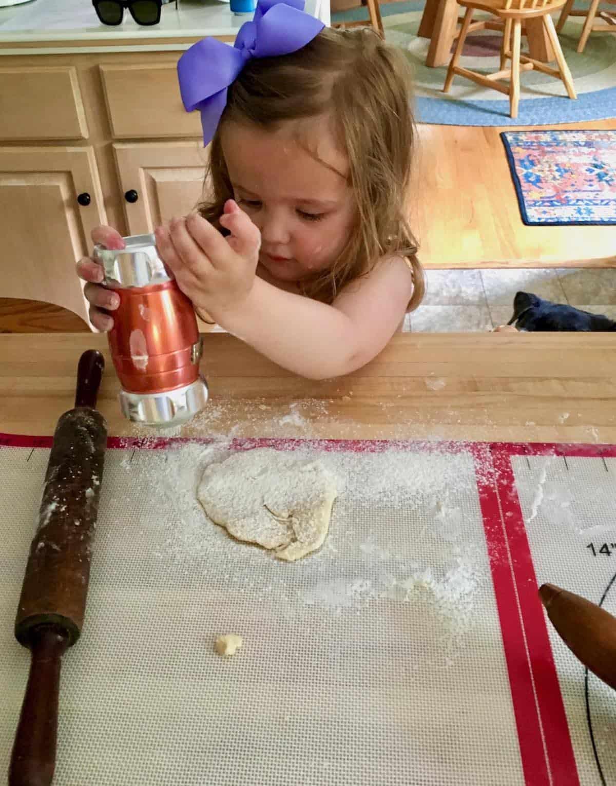 grand daughter rolling pie dough