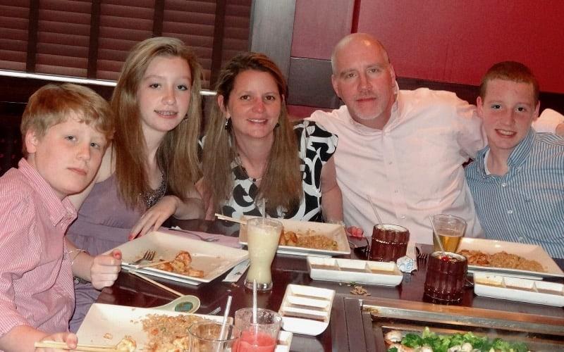Aidan and his family having dinner