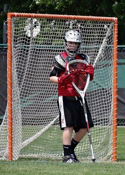 Aidan playing lacrosse