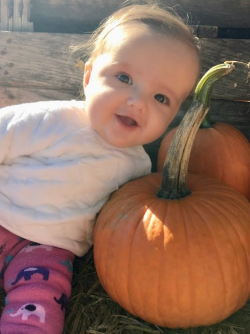 my granddaughter with a pumpkin