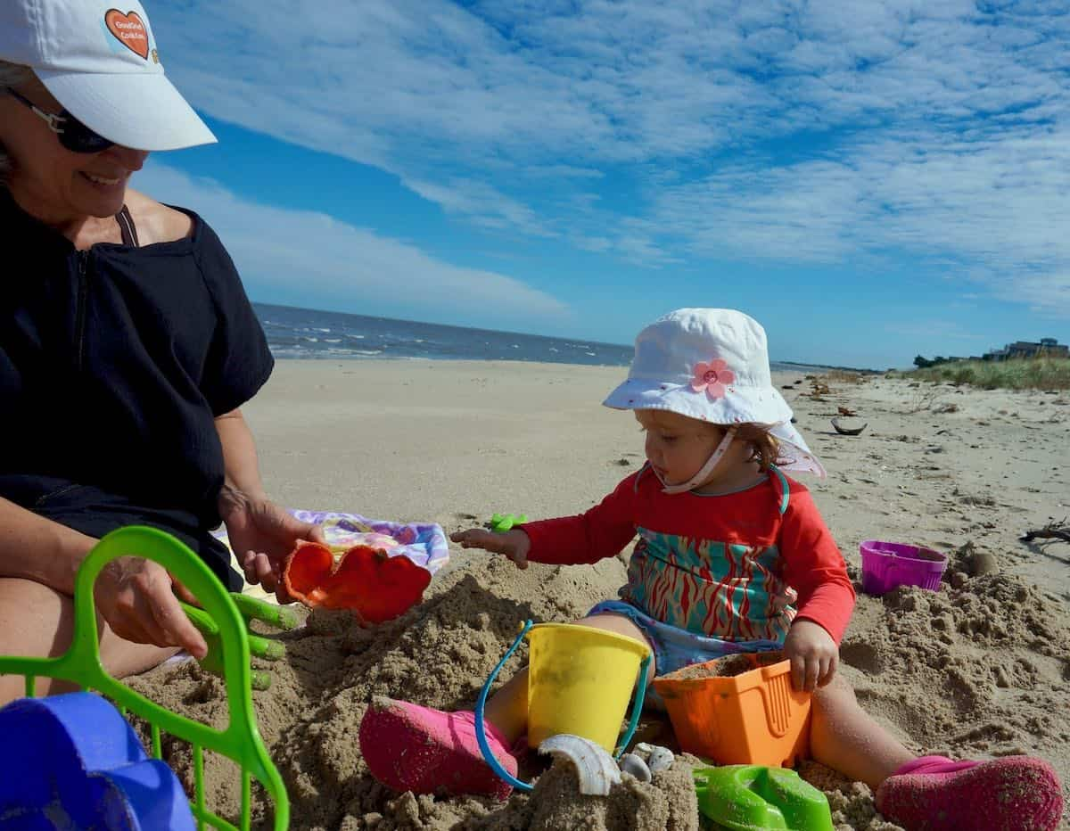 me and grand daughter playing at the beach