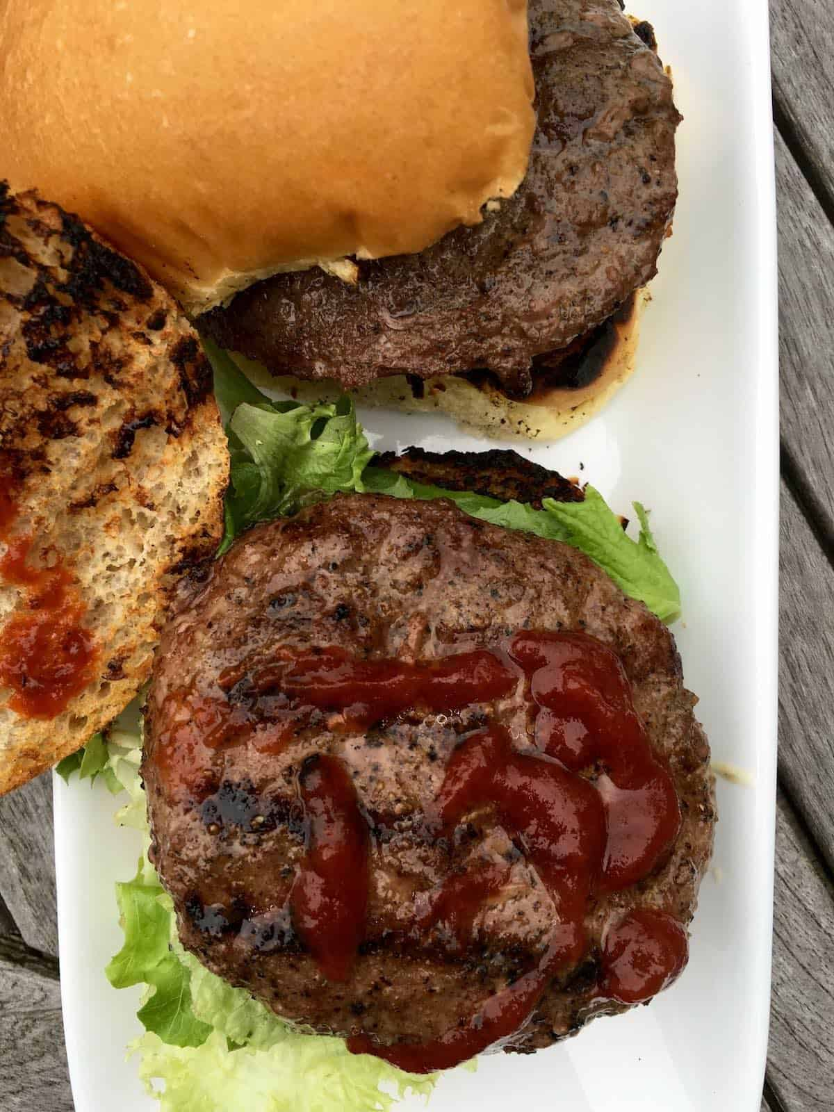 grilled burgers with ketchup and lettuce