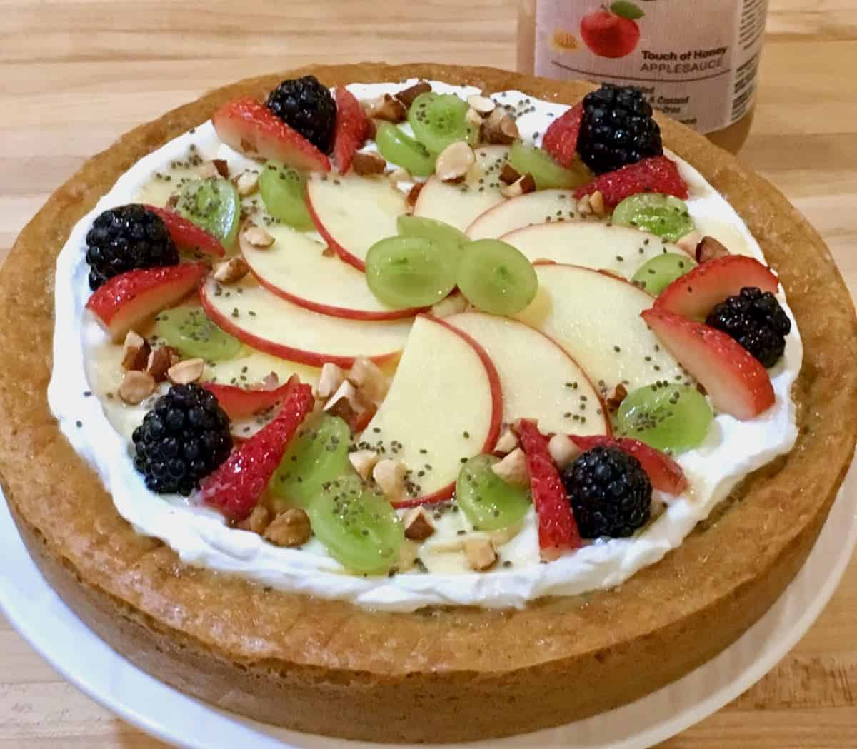 fresh fruit topped cake made with applesauce