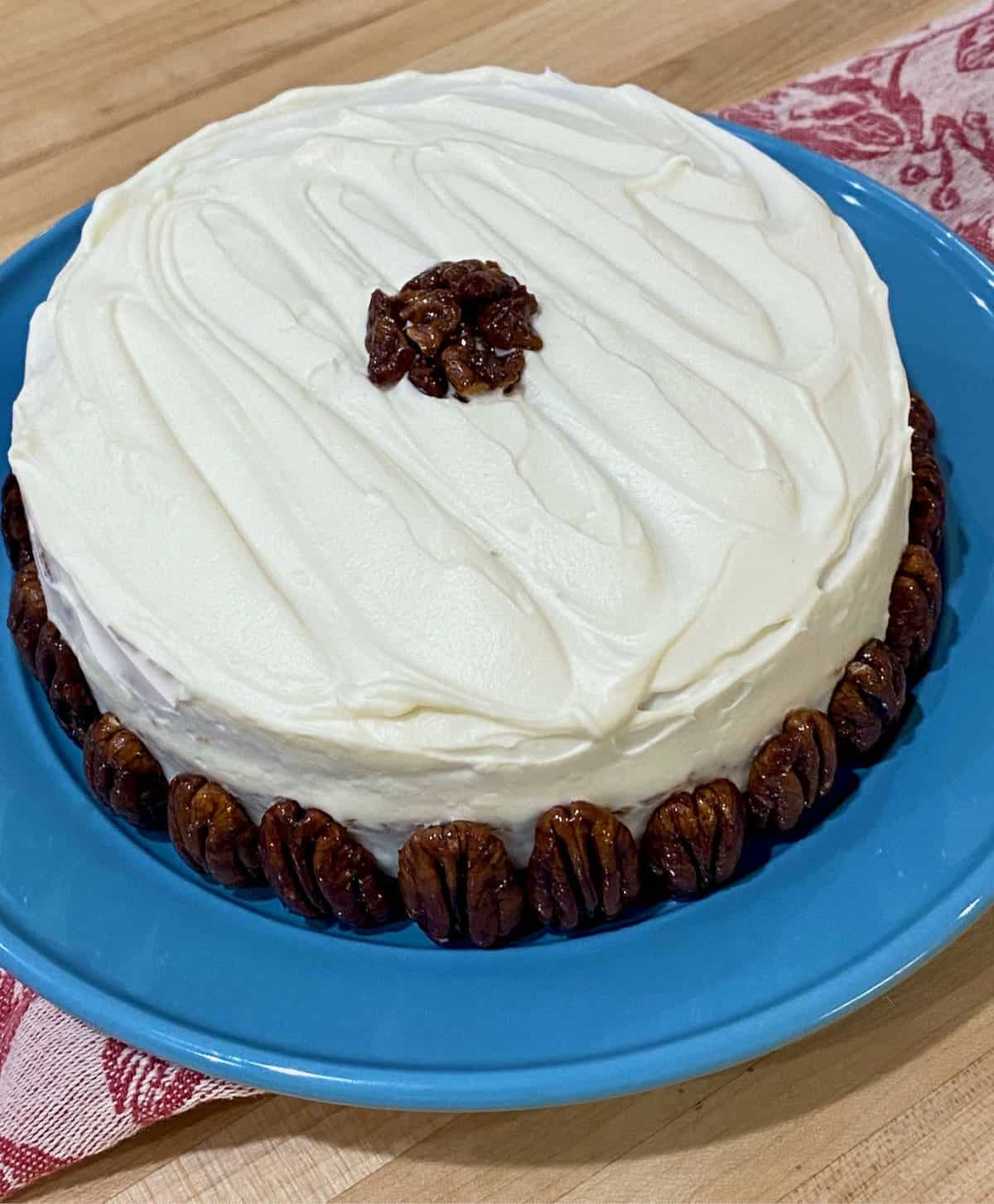 frosted carrot cake with pecans