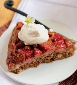 slice of strawberry rhubarb skillet cake with whipped cream