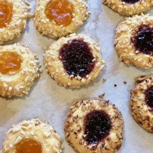 thumbprint jelly cookies on parchment