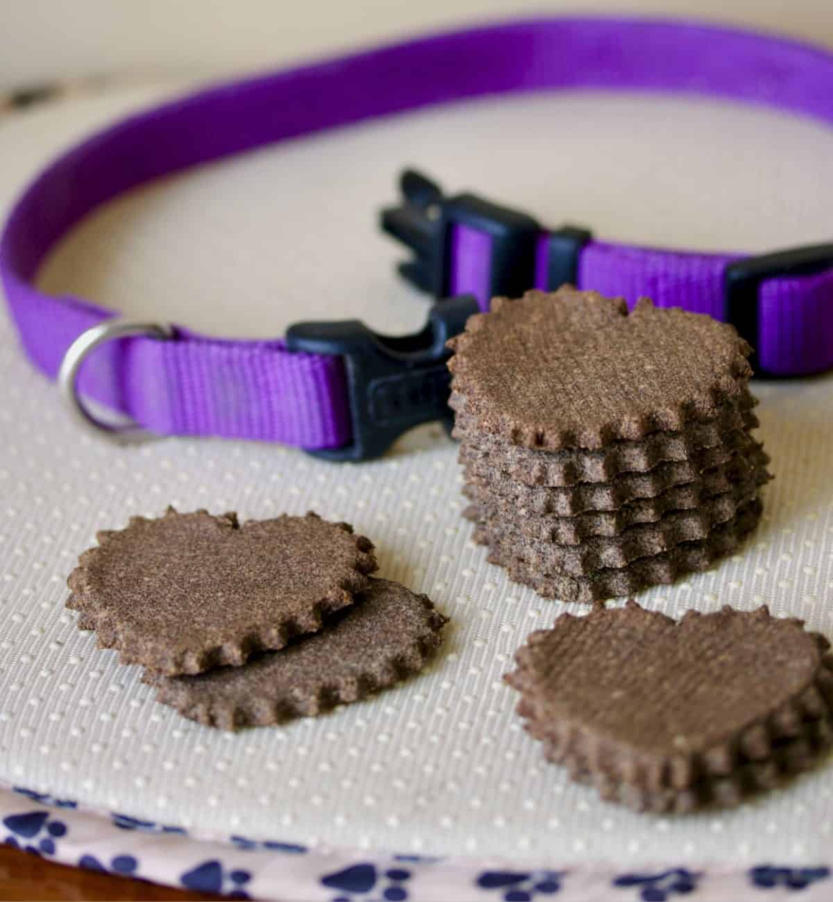 heart shaped dog biscuits and purple dog collar are best gifts
