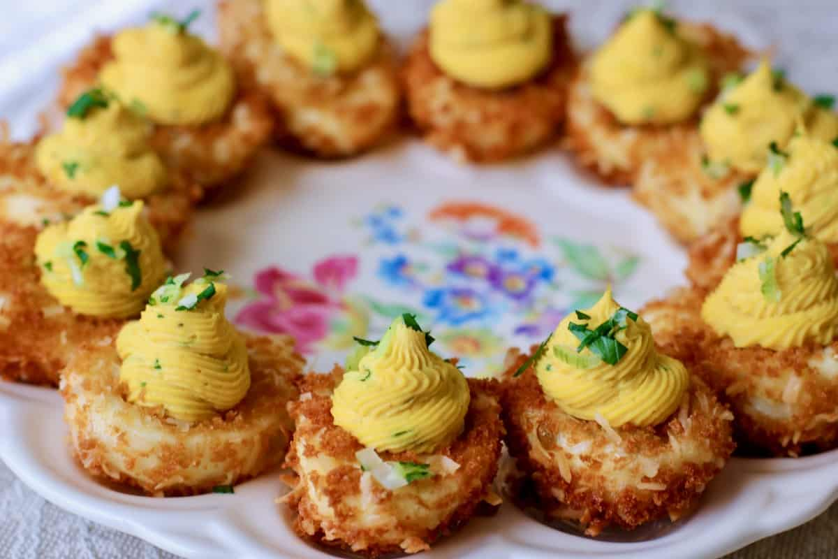 plate of crispy coconut curried devils eggs