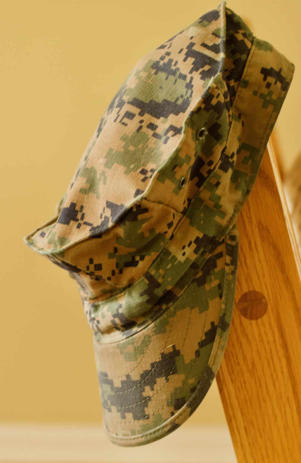 he wore many hats like this camouflage cap