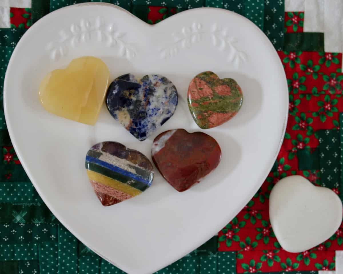 polished rock hearts on a white heart plate