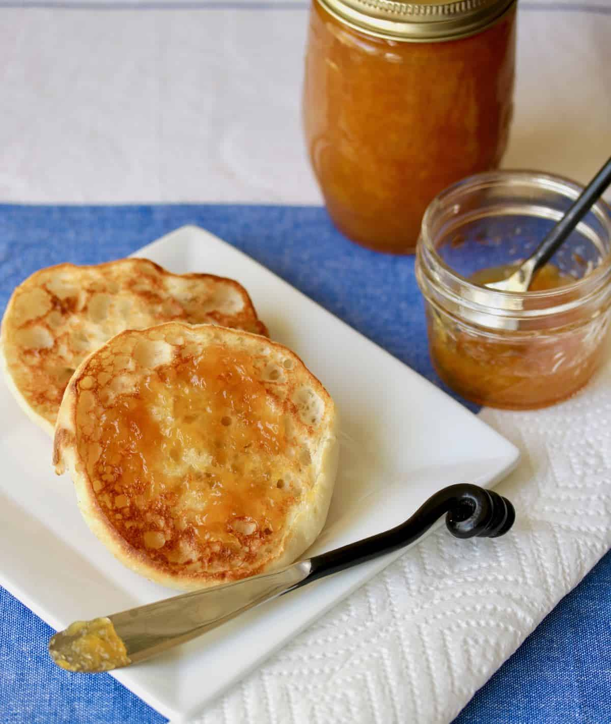 toasted English muffins with spirited peach jam