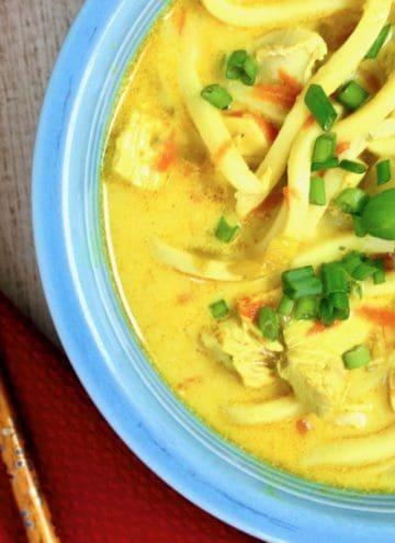 bowl of mulligatawny noodle soup with chop sticks