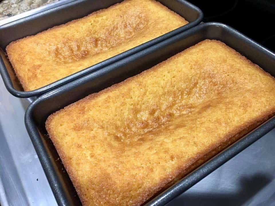 two baked loaf cakes with sunken centers