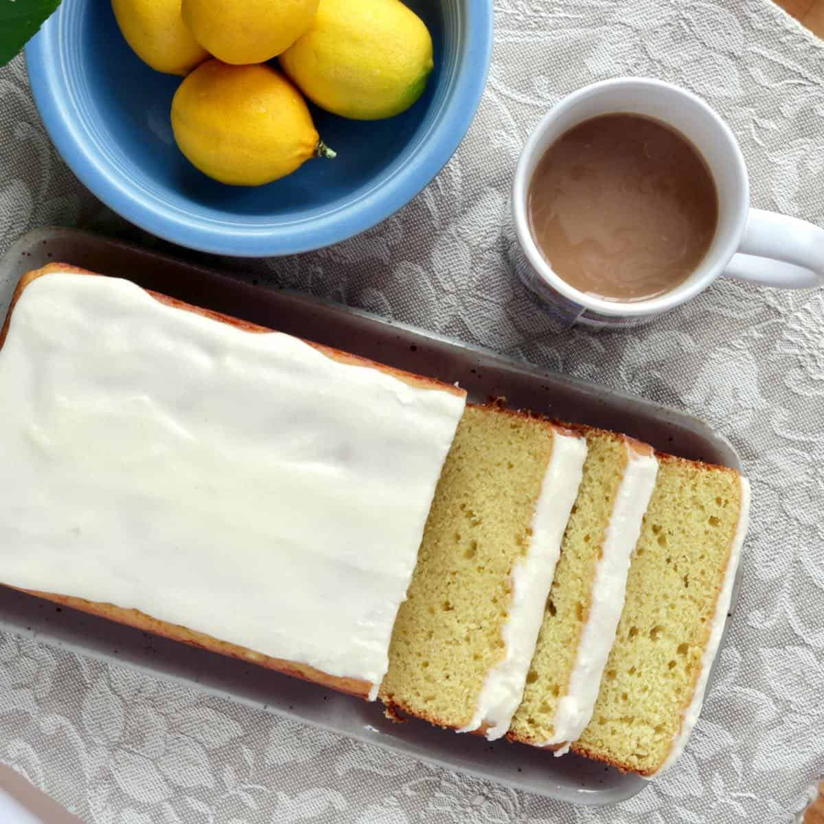 sliced lemon cake with cup of coffee