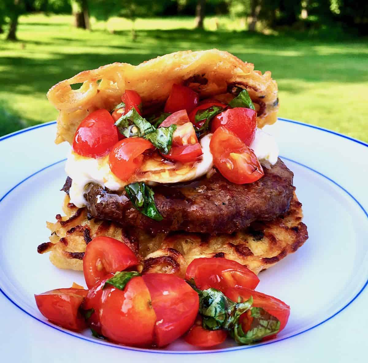 a recipe with yakisoba noodle bun burger with tomatoes and cheese