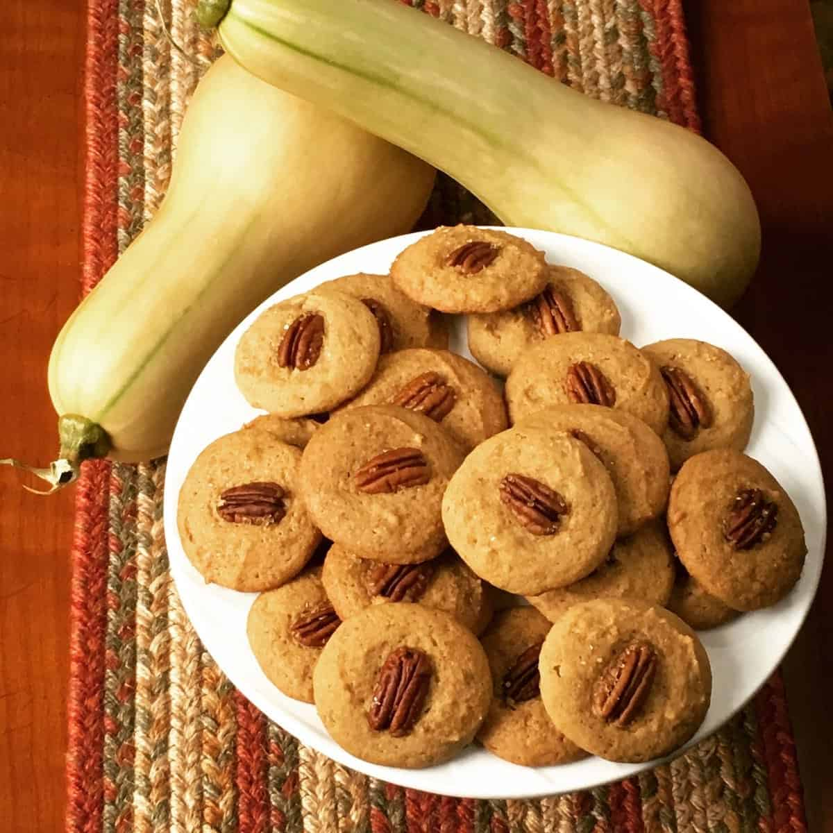 plate of pecan cookies with fresh picked butternut squash