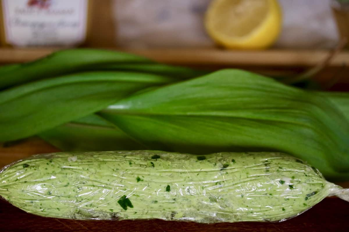 ramp butter wrapped in plastic with ingredients in background