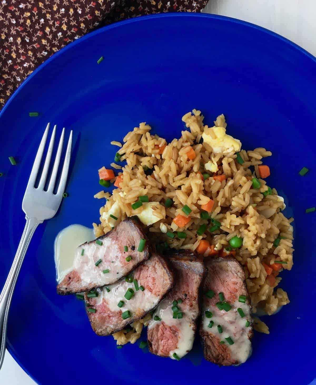 plated steak and fried rice turning the tables