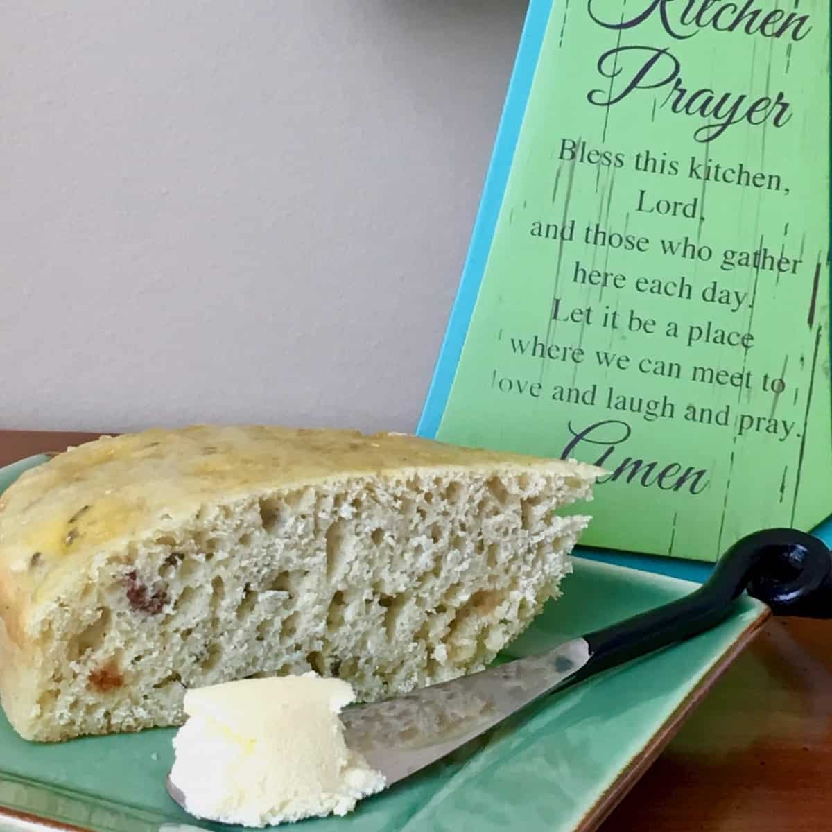 Kitchen prayer and plate of sliced Irish soda bread and butter