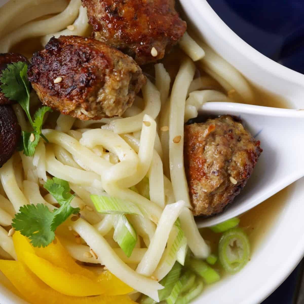 bowl of Asian meatball noodle soup