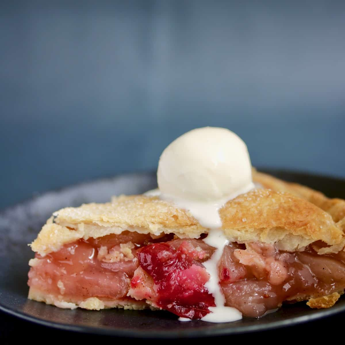 slice of sous vide apple pie with melted ice cream