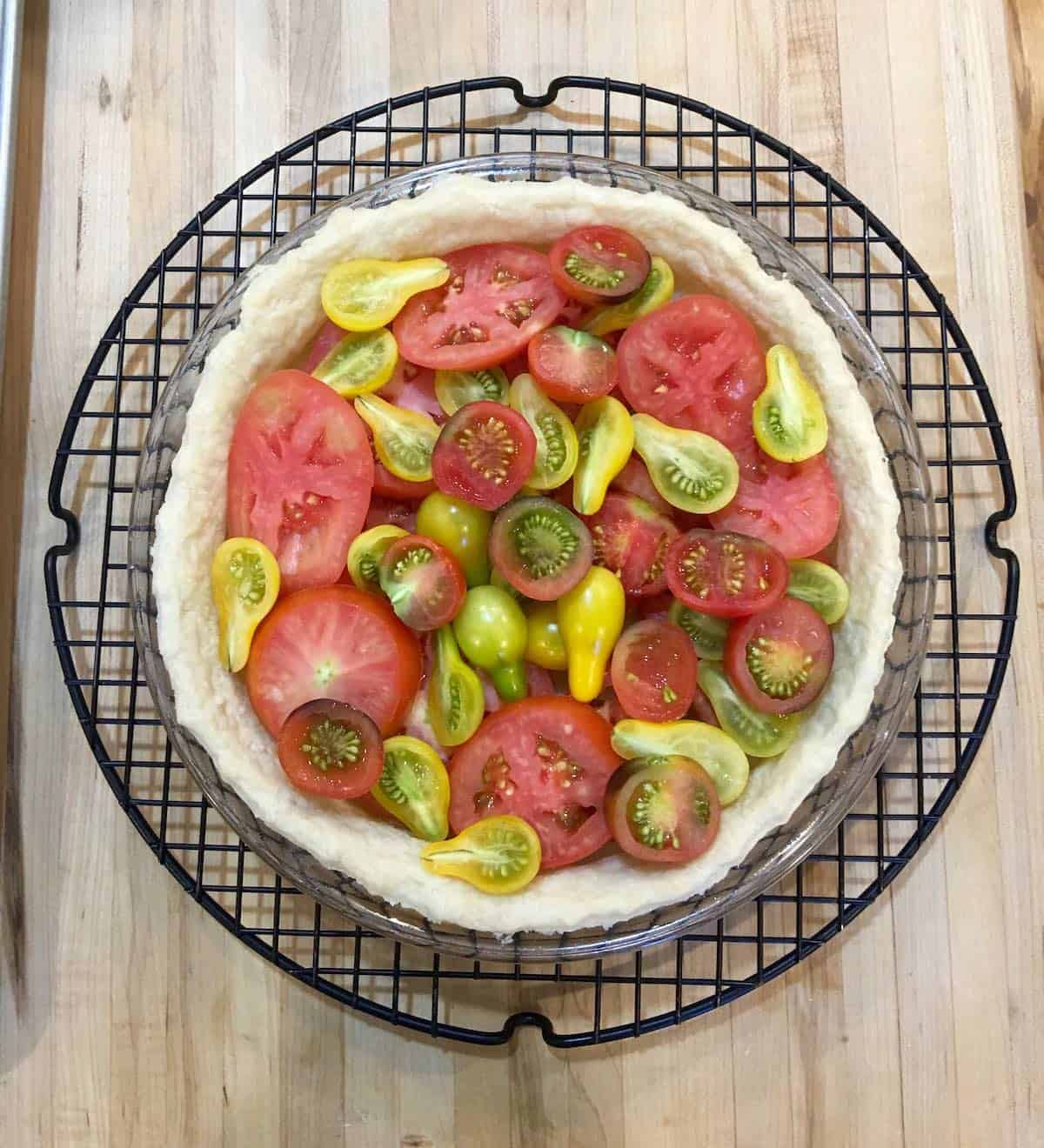 raw tomatoes in pie shell