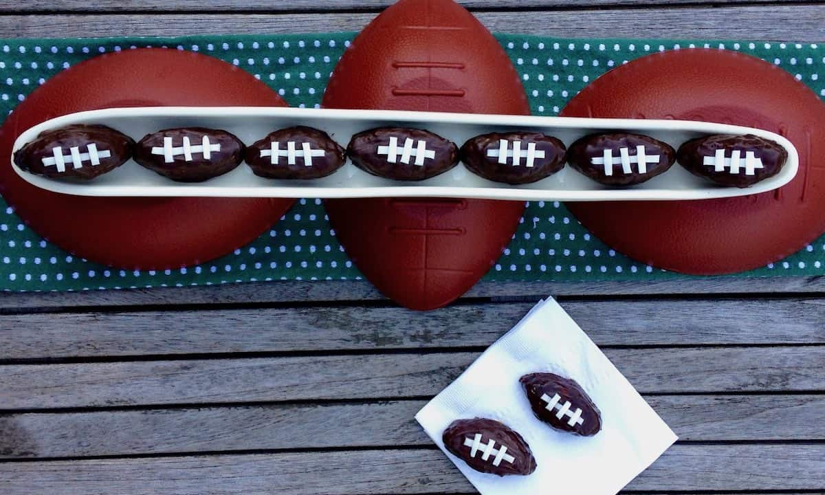 chocolate covered salted caramel PB pretzel balls  decorated to look like footballs